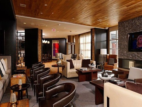 Gathering Room with Luxe Furnishings and Fireplace