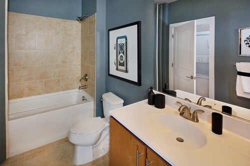 Plush Bathrooms With Granite or Quartz Counters