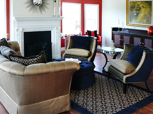 Living room with fireplace at Park Lane Villa Apartments in University Circle