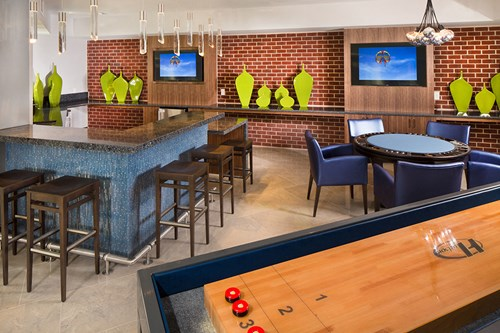 PLAY, Game Room with shuffleboard, billiards, poker table, and foosball
