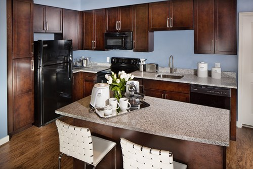 Large kitchen with pantry, island, and granite countertops