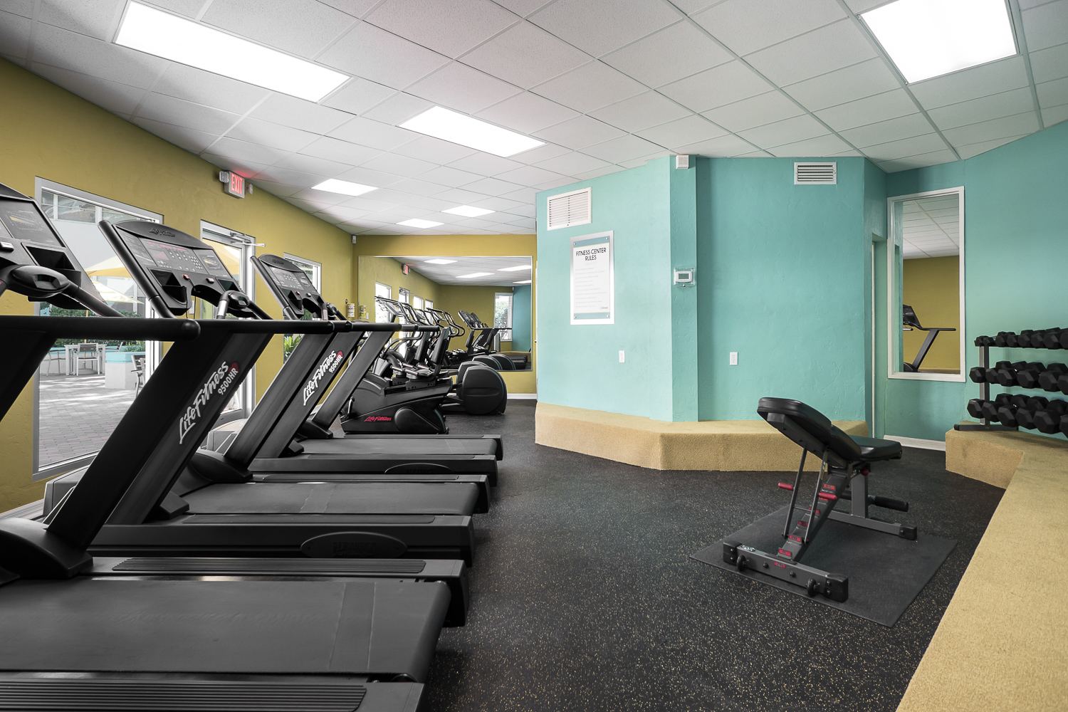 Free Weight & Cardio Fitness Center Overlooking Pool
