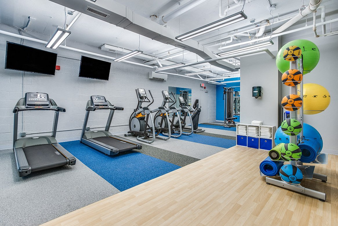 Residences at Rio apartments gym TV in Gaithersburg, Maryland