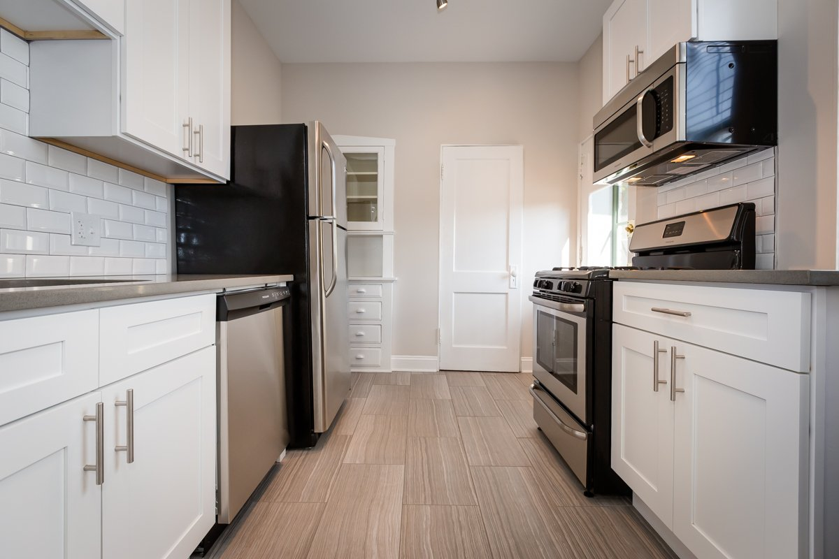 renovated kitchen stainless steel appliances vintage apartment chicago hyde park apartment