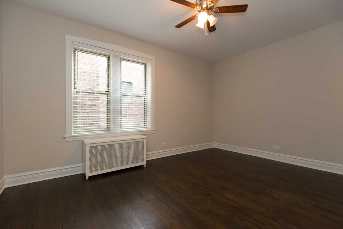 bedroom renovated hardwood floors hyde park chicago apartment remodeled