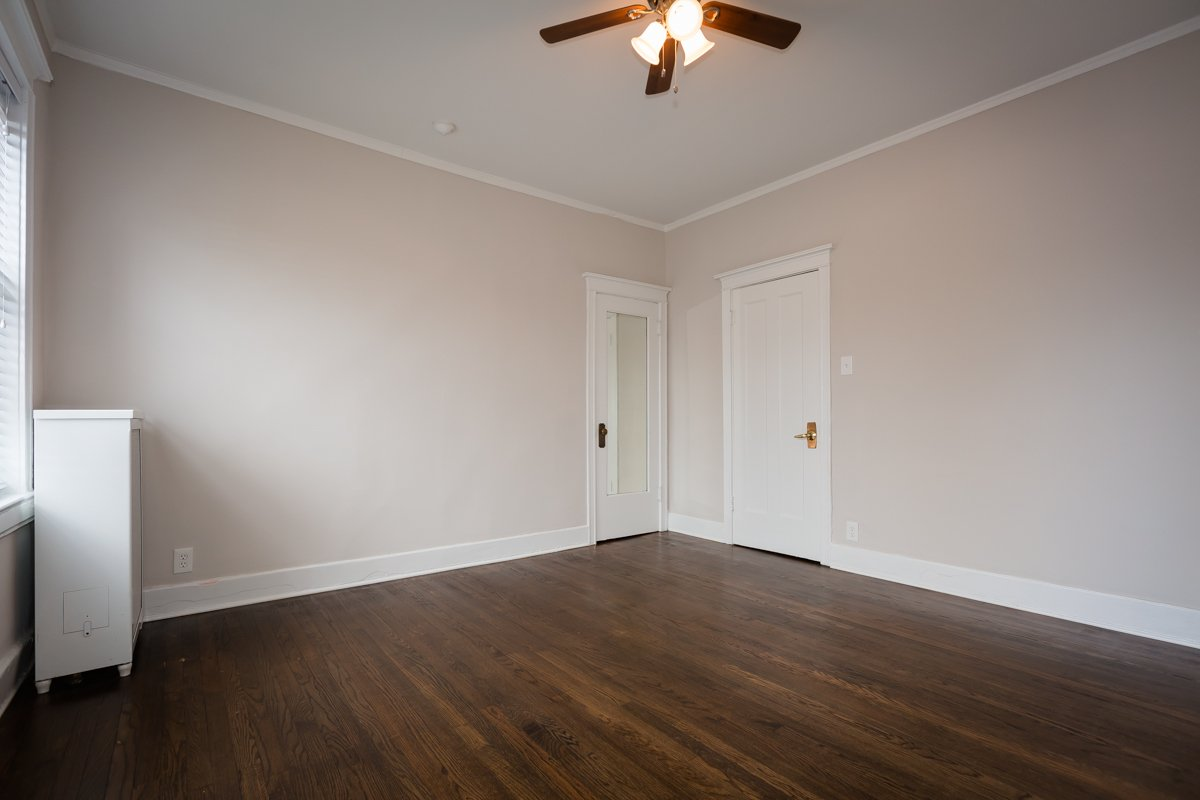 hardwood floor bedroom renovated apartment hyde park chicago rent