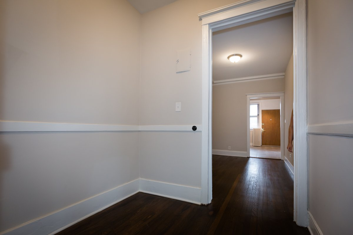 hallway nook hyde park chicago rent apartment hardwood floors trim remodel