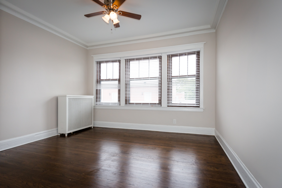hardwood floor bedroom renovated large windows open layout rent