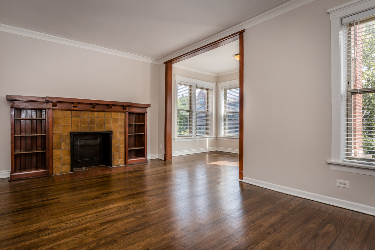 hardwood floors renovated apartment fireplace storage sunroom hyde park chicago remodel