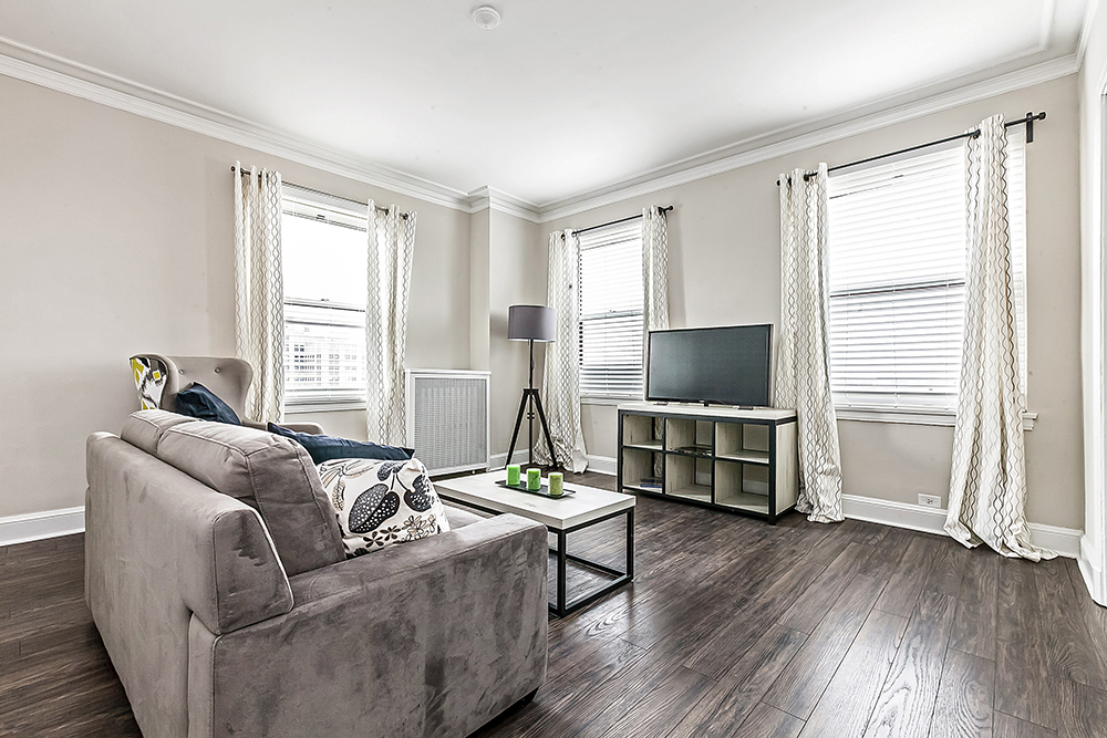 renovated living room with furniture at hyde park property management chicago apartments