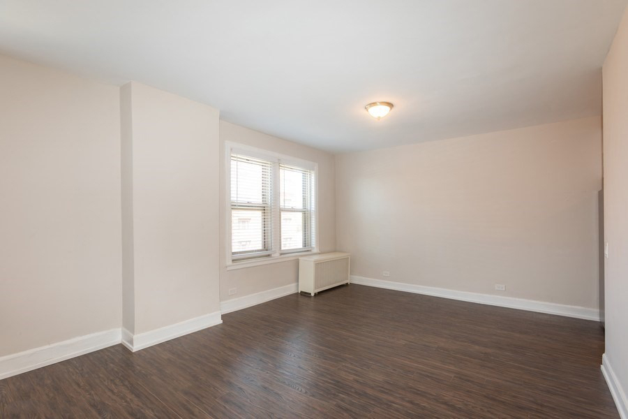 spacious living room hardwood floors renovated apartments hyde park chicago