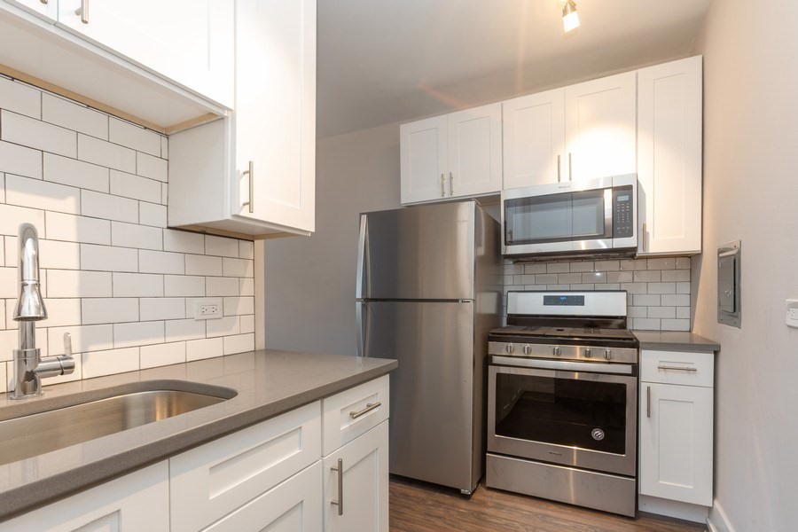 renovated kitchen stainless steel appliances modern kitchen apartments hyde park chicago